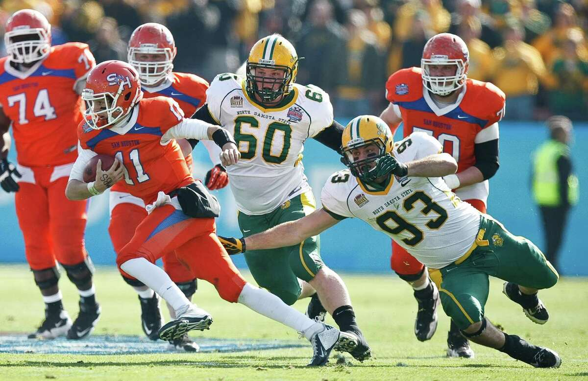 Sam Houston State quarterback Brian Bell (11) scrambles for a first down as North Dakota State defensive end Cole Jirik (93) and North Dakota State defensive tackle Ryan Drevlow (60) chase him during the first quarter of the NCAA Division One Football Championship, Saturday, Jan. 5, 2013, in Dallas FC Stadium in Frisco.