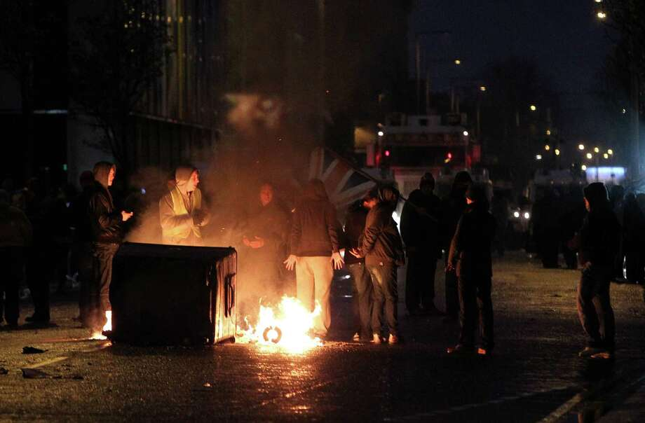 Loyalist protesters burn debris on the lower Newtownards road in Belfast, Northern Ireland on January 5, 2013. Nine officers were injured and 18 people arrested in fresh violence overnight on the streets of Belfast, police said on January 5. Tensions have risen in the British province since councillors voted on December 3, 2012 to limit the number of days the Union flag can fly over the City Hall to 17, outraging loyalists who believe Northern Ireland should retain strong links to Britain. AFP PHOTO / PETER MUHLYPETER MUHLY/AFP/Getty Images Photo: PETER MUHLY, AFP/Getty Images / AFP