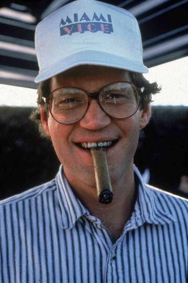 1985: David Letterman, wearing a baseball cap from the television series, 'Miami Vice,' biting a cigar. Getty Images