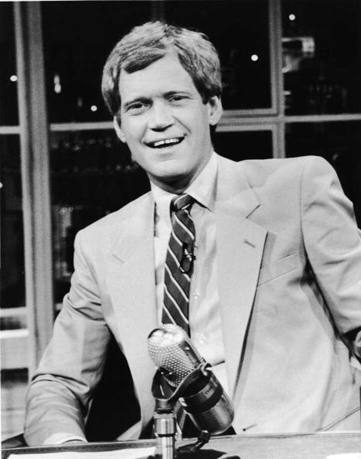 1986: David Letterman sits at his desk on the television series 'Late Night with David Letterman,' New York, New York. Getty Images