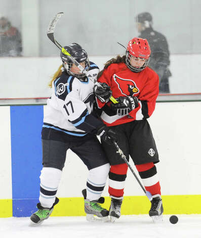 Wilton's Jenny Hojnacki, left, # 17, and Erika Hvolbeck # 7 of Greenwich mix ir up over for a loose puck during the girls high school ice hockey game between Wilton High School and Greenwich High School at the SoNo Ice House in Norwalk, Saturday, Jan. 5, 2013. Greenwich won the game, 4-3. Photo: Bob Luckey / Greenwich Time