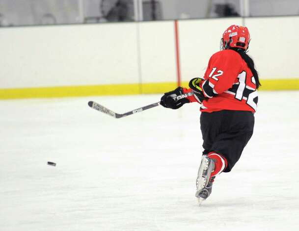 Monica Stevenson # 12 of Greenwich shoots during the girls high school ice hockey game between Wilton High School and Greenwich High School at the SoNo Ice House in Norwalk, Saturday, Jan. 5, 2013. Greenwich won the game, 4-3. Photo: Bob Luckey / Greenwich Time