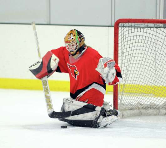 Greenwich goalie Lisa Lewis makes a stop during the girls high school ice hockey game between Wilton High School and Greenwich High School at the SoNo Ice House in Norwalk, Saturday, Jan. 5, 2013. Greenwich won the game, 4-3. Photo: Bob Luckey / Greenwich Time
