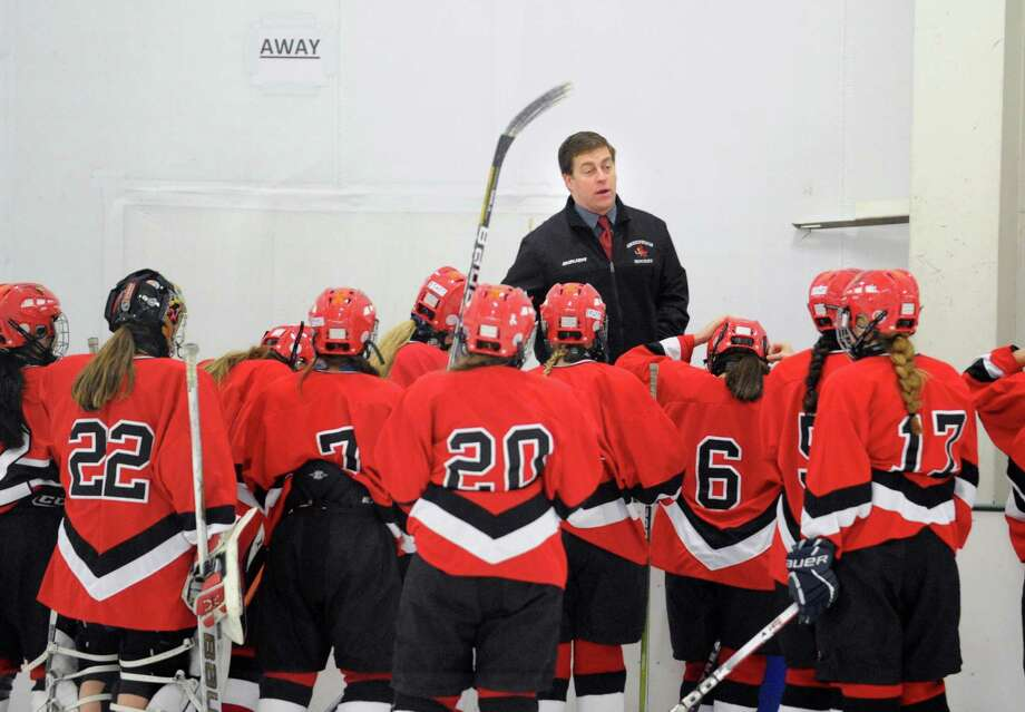 Greenwich girls ice hockey coach Brett Farson gives his team a pep-talk during the girls high school ice hockey game between Wilton High School and Greenwich High School at the SoNo Ice House in Norwalk, Saturday, Jan. 5, 2013. Greenwich won the game, 4-3. Photo: Bob Luckey / Greenwich Time