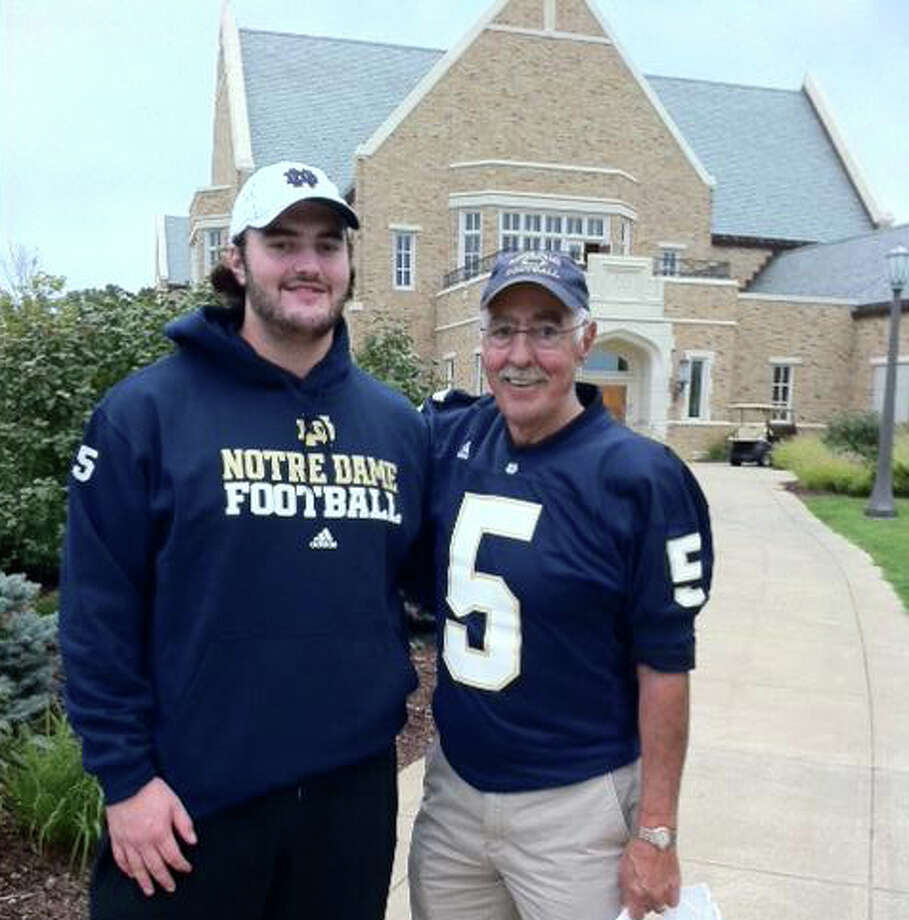 Notre Dame offensive lineman and New Canaan native Conor Hanratty, left, poses with his father Terry at the schools campus in South Bend, Ind. last year. Terry played quarterback at Notre Dame, leading the Irish to the 1966 national championship. Photo: Contributed Photo