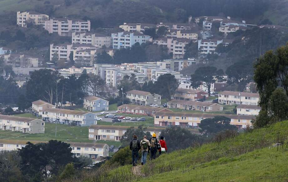 Day hikers walk on a section of Philosopher's Way above Visitacion Valley at McLaren Park in San Francisco, Calif. on Saturday, Jan. 5, 2013, after the new 2.7 mile loop trail officially opened. Photo: Paul Chinn, The Chronicle
