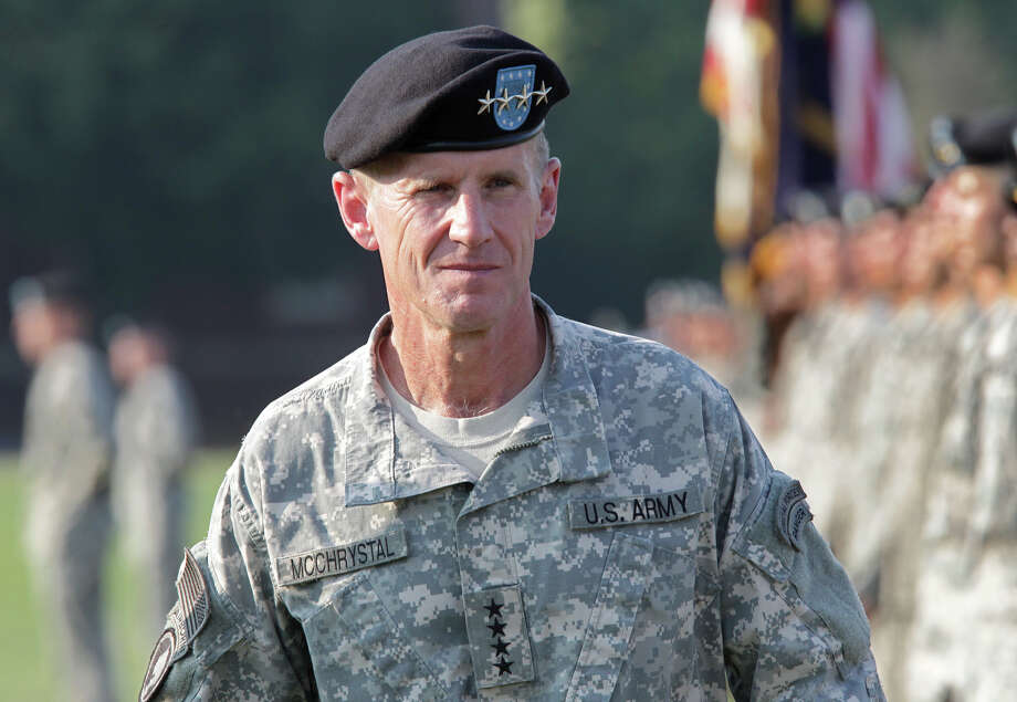 FILE - This July 23, 2010, file photo shows Gen. Stanley McChrystal reviewing troops for the last time as he is honored at a retirement ceremony at Fort McNair in Washington. Speaking out for the first time since he resigned, retired Gen. Stanley McChrystal writes in a new memoir that he takes the blame for the Rolling Stone article that ended his Afghan command and army career, including for the unflattering comments attributed to his staff about the Obama administration. (AP Photo/J. Scott Applewhite, file) Photo: J. Scott Applewhite