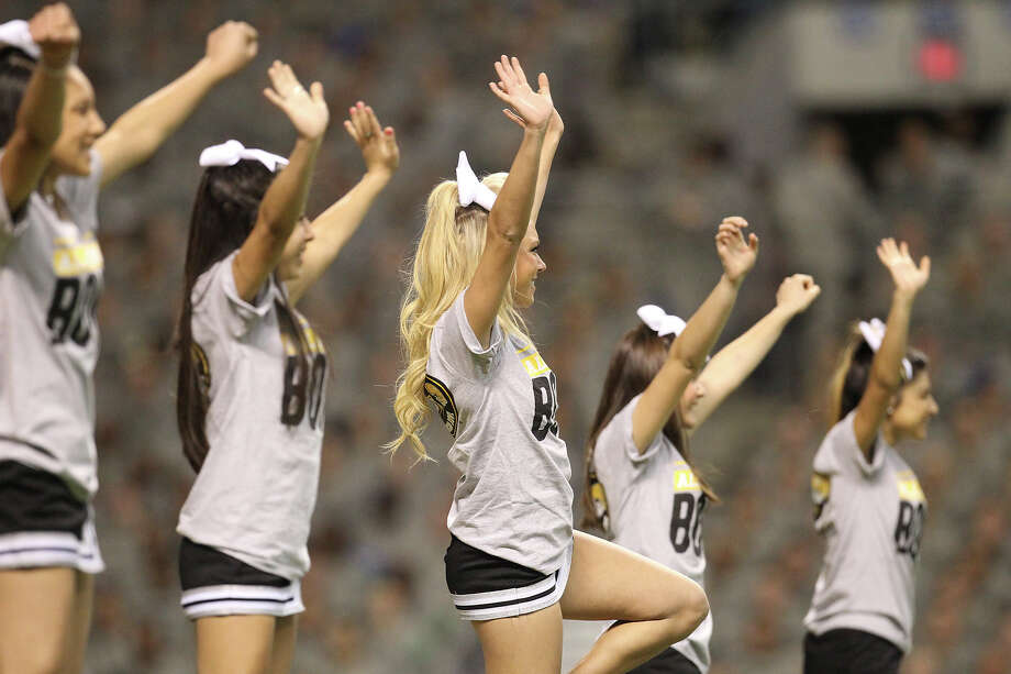 Steele High School cheerleaders perform during a timeout in the 2013 U.S. Army All-American Bowl at the Alamodome on Saturday, Jan. 5, 2013. The East Team defeated the West, 15-8. Photo: Kin Man Hui, Express-News / © 2012 San Antonio Express-News