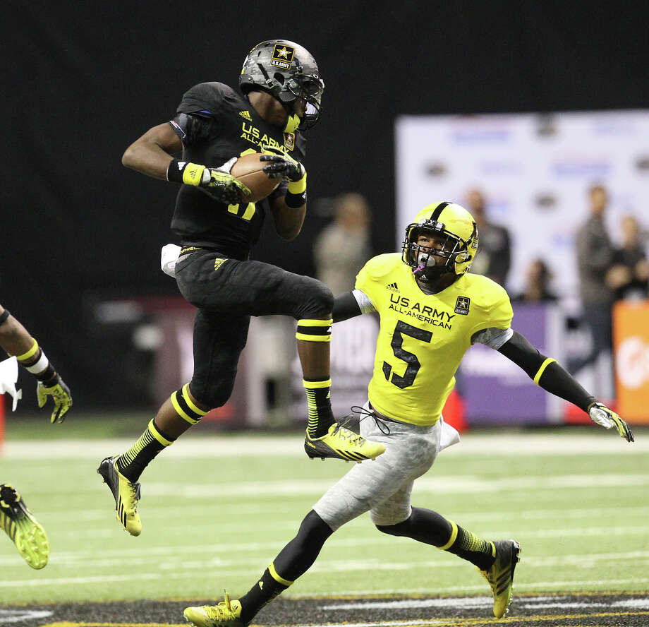 James Quick (17) of Trinity High School in Louisville, Kentucky makes a leaping catch in front of Tahaan Goodman (05) from Rancho Cucamonga, California in the first half of the 2013 U.S. Army All-American Bowl at the Alamodome on Saturday, Jan. 5, 2013. The East Team defeated the West, 15-8. Photo: Kin Man Hui, Express-News / © 2012 San Antonio Express-News