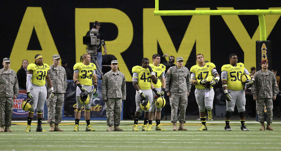 Players from the West Team stand alongside U.S. Army personnel during introductions of the 2013 U.S. Army All-American Bowl at the Alamodome on Saturday, Jan. 5, 2013. The East Team defeated the West, 15-8. Photo: Kin Man Hui, Express-News / © 2012 San Antonio Express-News