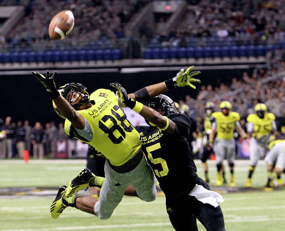 Corey Robinson (88) of San Antonio Christian lunges for a catch attempt against Kendall Fuller (05) of Our Lady of Good Counsel in Olney, Maryland during the first half of the 2013 U.S. Army All-American Bowl at the Alamodome on Saturday, Jan. 5, 2013. The East Team defeated the West, 15-8. Photo: Kin Man Hui, Express-News / © 2012 San Antonio Express-News