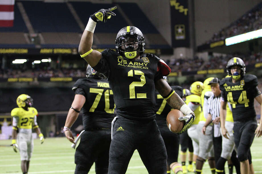 Derrick Henry (02) of Yulee High School in Yulee, Florida reacts after scoring a touchdown in the first half of the 2013 U.S. Army All-American Bowl at the Alamodome on Saturday, Jan. 5, 2013. The East Team defeated the West, 15-8. Photo: Kin Man Hui, Express-News / © 2012 San Antonio Express-News