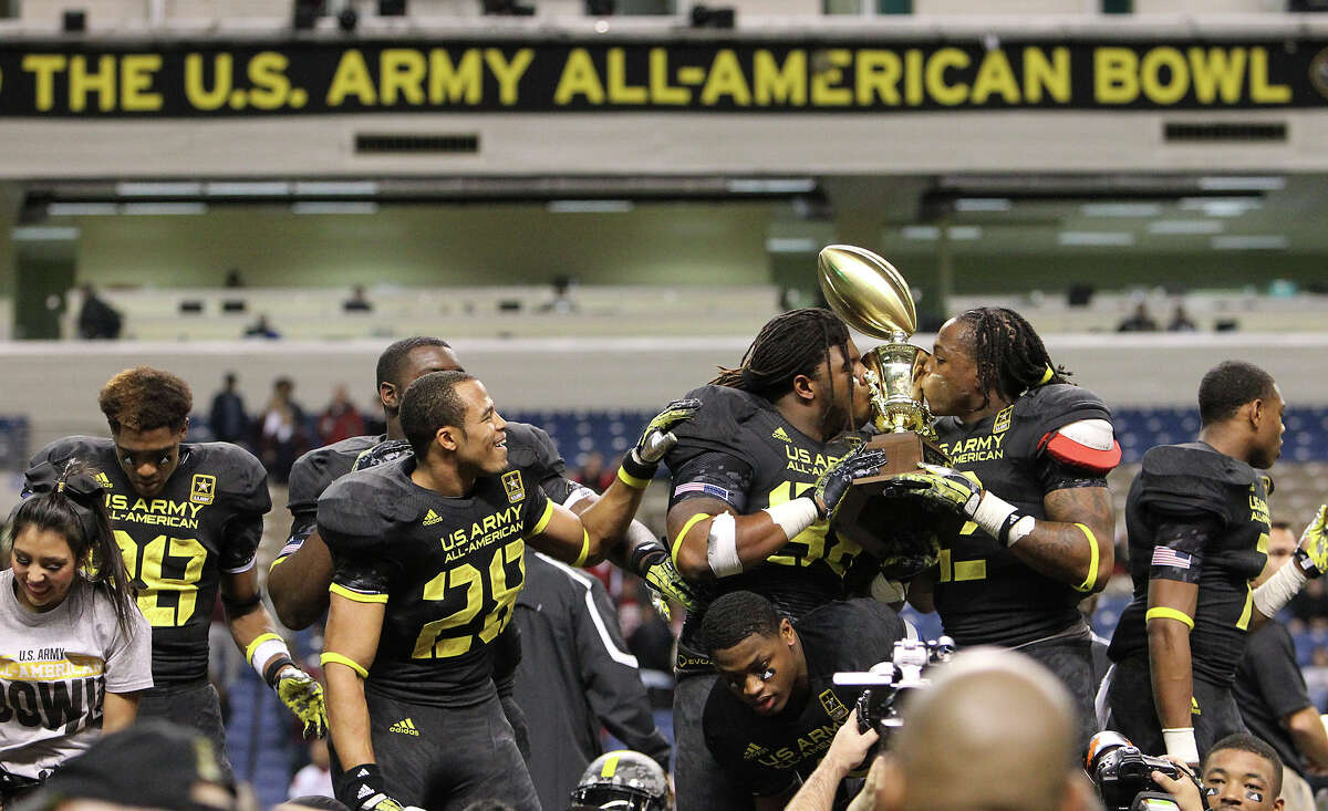 Kenny Bigelow (left) and Derrick Henry (right) kiss the championship trophy after the East Team defeated the West, 15-8, in the 2013 U.S. Army All-American Bowl at the Alamodome on Saturday, Jan. 5, 2013.