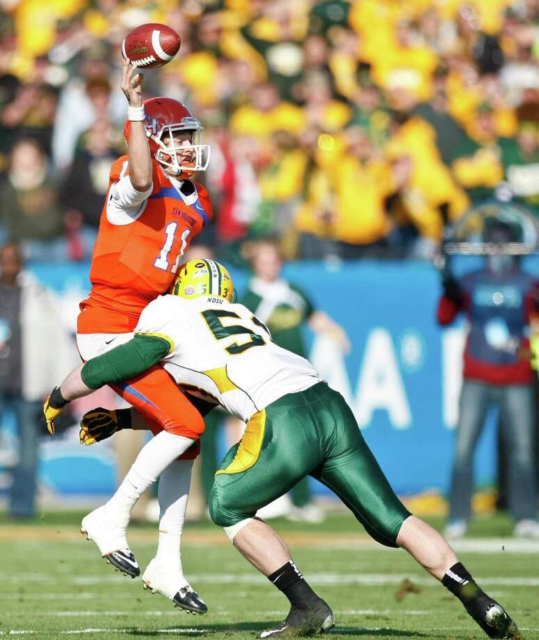 Sam Houston State quarterback Brian Bell (11) is hit and injured by North Dakota State defensive end Kyle Emanuel (53) during the third quarter of the NCAA Division One Football Championship, Saturday, Jan. 5, 2013, in Dallas FC Stadium in Frisco. Photo: Nick De La Torre, Houston Chronicle / © 2013  Houston Chronicle