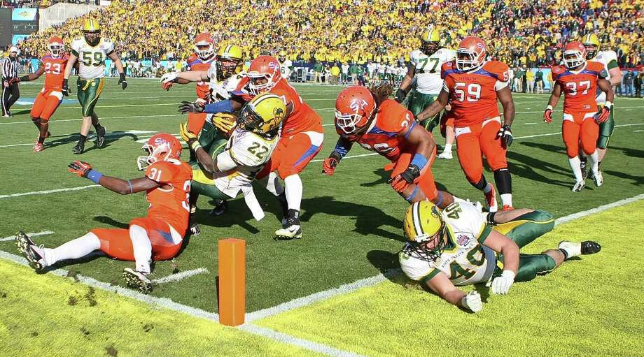 North Dakota State running back Sam Ojuri (22) is stopped short of scoring a touchdown by the Sam Houston State defense during the fourth quarter of the NCAA Division One Football Championship, Saturday, Jan. 5, 2013, in Dallas FC Stadium in Frisco. Photo: Nick De La Torre, Houston Chronicle / © 2013  Houston Chronicle