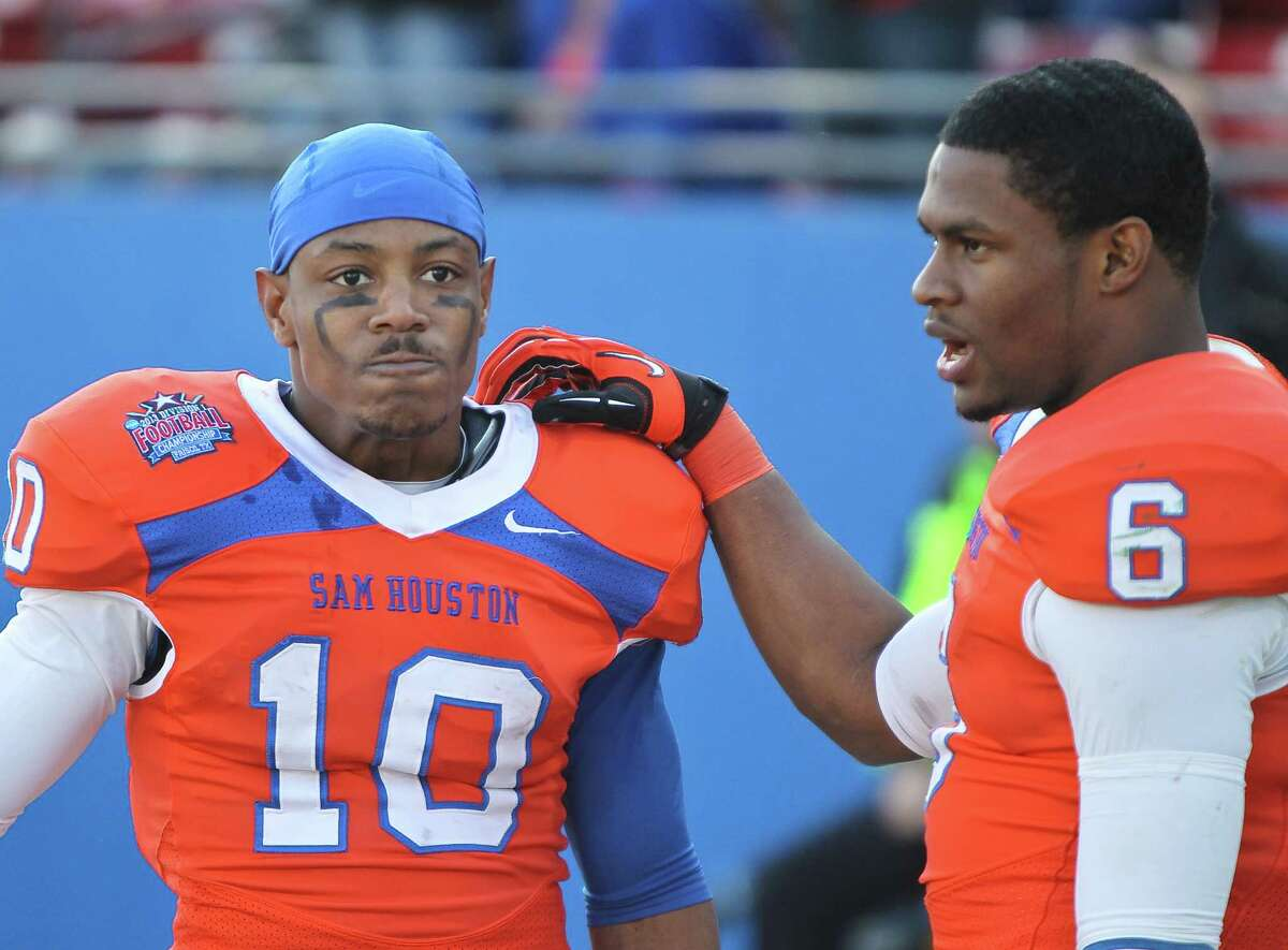 Sam Houston State wide receiver Torrance Williams (10) is consoled by Sam Houston State wide receiver Richard Sincere (6) as time comes to an end during the fourth quarter of the NCAA Division One Football Championship against North Dakota State , Saturday, Jan. 5, 2013, in Dallas FC Stadium in Frisco.