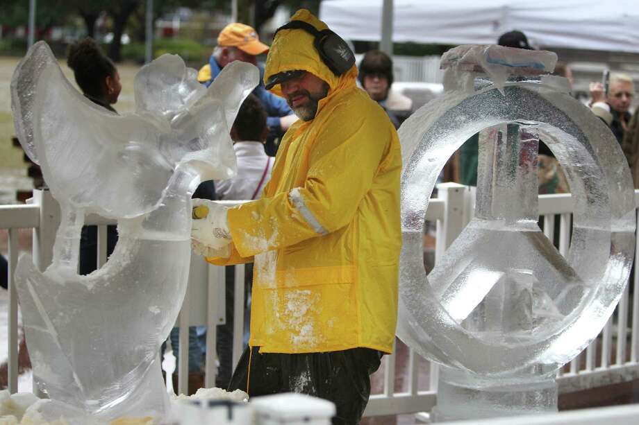 Aaron Costic competes for a cash price in The Magnificent 7 Ice Carving Competition at Discovery Green on Saturday, Jan. 5, 2013, in Houston. Photo: Mayra Beltran, Houston Chronicle / © 2012 Houston Chronicle