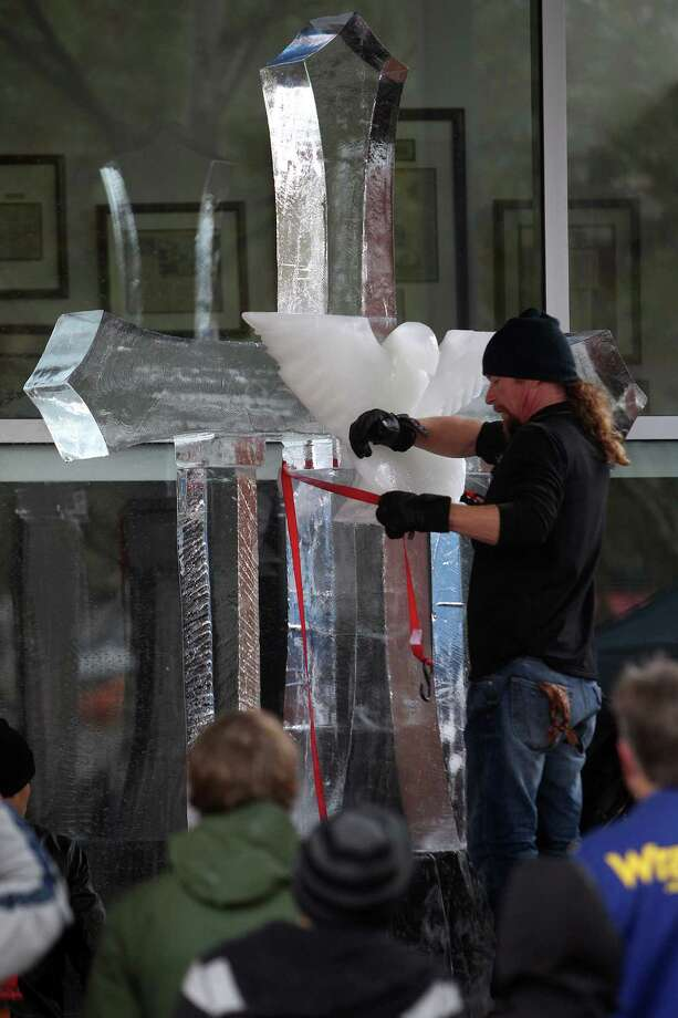 Buddy Rasmussen is near completion during The Magnificent 7 Ice Carving Competition at Discovery Green on Saturday, Jan. 5, 2013, in Houston. Photo: Mayra Beltran, Houston Chronicle / © 2012 Houston Chronicle