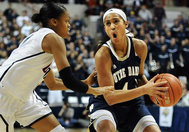 Notre Dame's Skylar Diggins, right, is guarded by Connecticut's Moriah Jefferson, left, during the first half of an NCAA college basketball game in Storrs, Conn., Saturday, Jan. 5, 2013. (AP Photo/Jessica Hill) Photo: Jessica Hill, Associated Press / FR125654 AP