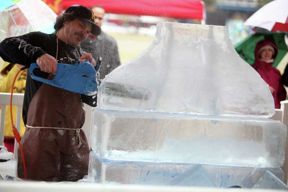 Danny Bloss shapes the ice at the start of The Magnificent 7 Ice Carving Competition at Discovery Green on Saturday, Jan. 5, 2013, in Houston.  Artist are given 7 blocks of ice, and a time frame of 5 hours to complete sculpture. Photo: Mayra Beltran, Houston Chronicle / © 2012 Houston Chronicle