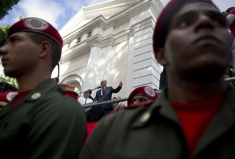 Diosdado Cabello speaks outside Venezuela's National Assembly in Caracas. Cabello could step in as a caretaker leader if President Hugo Chavez isn't healthy enough to take the oath of office. Photo: Raul Arboleda, AFP/Getty Images