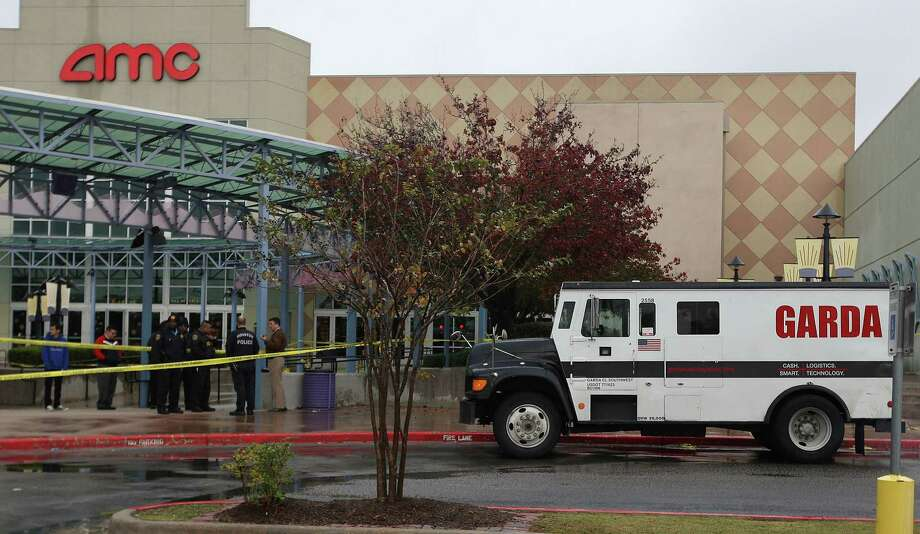 Police investigate the scene of an attempted armored car robbery outside the AMC Studio 30 Theaters Saturday, Jan. 5, 2013, in Houston. One armored car guard was shot and one robbery suspect was shot. More details in this story. Photo: James Nielsen, Chronicle / © Houston Chronicle 2012
