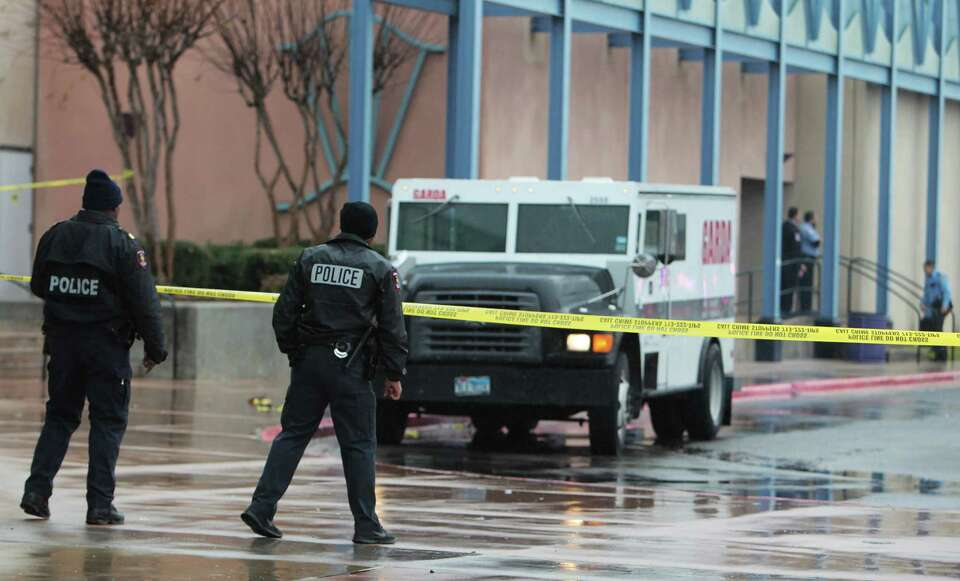 Police investigate the scene of an attempted armored car robbery outside the AMC Studio 30 Theaters