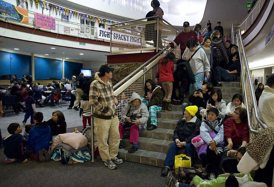 People gather at Sitka High School early Saturday, Jan. 5, 2013, in Sitka, Alaska, following a magnitude 7.5 earthquake and after a subsequent tsunami warning was declared for hundreds of miles of Alaskan and Canadian coastline. The alert was canceled when no damaging waves were generated. Photo: James Poulson, Associated Press