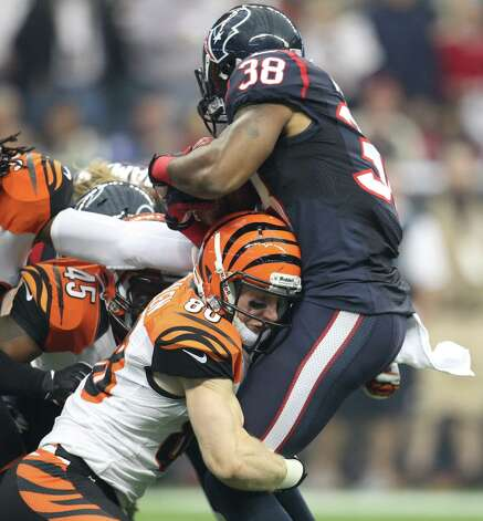 Houston Texans kick returner Danieal Manning (38) is hit by the Cincinnati Bengals  Ryan Whalen (88) on the opening kickoff on during the first quarter of an AFC playoff game at Reliant Stadium, Thursday, Jan. 6, 2000, in Houston. Photo: Karen Warren, Houston Chronicle / © 2012 Houston Chronicle