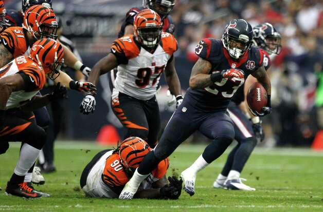Houston Texans running back Arian Foster (23) runs through the Cincinnati Bengals defense during the second quarter of an AFC playoff game at Reliant Stadium on Saturday, Jan. 5, 2013, in Houston. Photo: Brett Coomer, Houston Chronicle / © 2013  Houston Chronicle