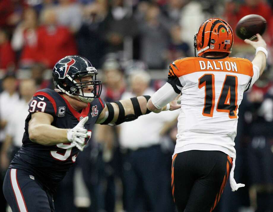 Houston Texans defensive end J.J. Watt (99) applies pressure to Cincinnati Bengals quarterback Andy Dalton (14) during the second quarter of an AFC playoff game at Reliant Stadium on Saturday, Jan. 5, 2013, in Houston. Photo: Brett Coomer, Houston Chronicle / © 2013  Houston Chronicle