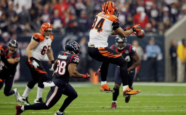 Cincinnati Bengals tight end Jermaine Gresham (84) can't catch a pass as Houston Texans free safety Danieal Manning (38) defends during the first quarter of an AFC playoff game at Reliant Stadium on Saturday, Jan. 5, 2013, in Houston. Photo: Brett Coomer, Houston Chronicle / © 2013  Houston Chronicle