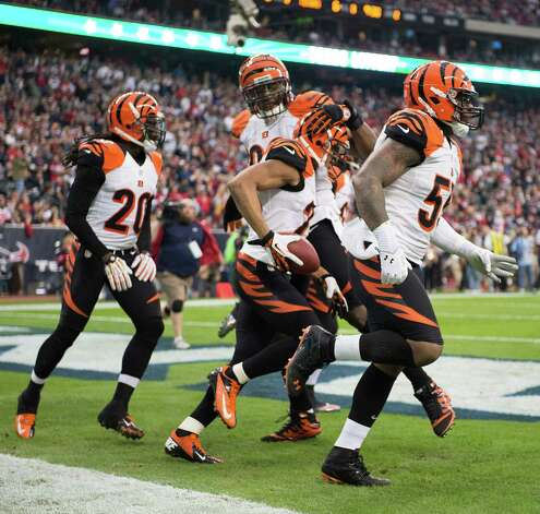 Cincinnati Bengals cornerback Leon Hall (29) celebrates after returning an interception for a touchdown during the first half of an NFL playoff football game against the Houston Texans at Reliant Stadium on Saturday, Jan. 5, 2013, in Houston. Photo: Smiley N. Pool, Houston Chronicle / © 2013  Houston Chronicle