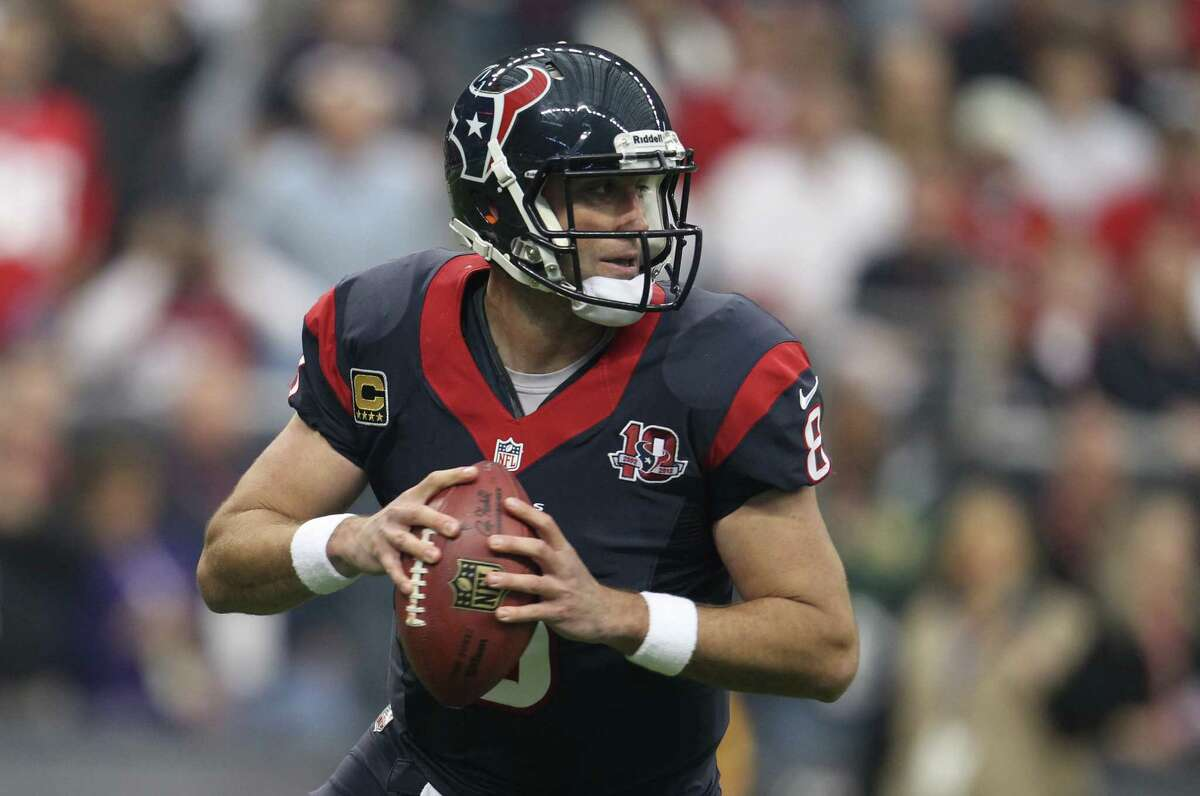 Houston Texans quarterback Matt Schaub (8) looks for a receiver against the Cincinnati Bengals during the first quarter of an AFC playoff game at Reliant Stadium, Thursday, Jan. 6, 2000, in Houston.