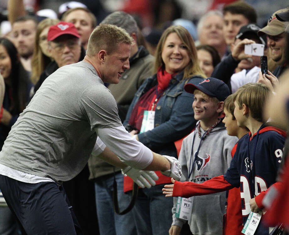 Texans defensive end J.J. Watt (99) greets the crowd on the sidelines as he warms up before the start of the game. (Karen Warren / Chronicle) Photo: Karen Warren, Houston Chronicle / © 2012 Houston Chronicle
