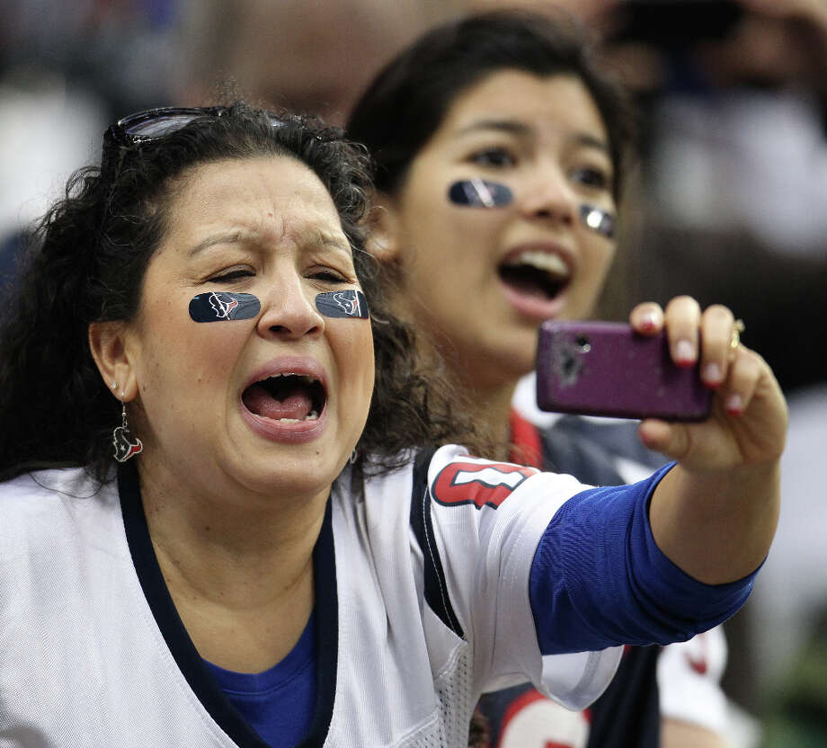 Jennifer Cardenas, of Lake Jackson, screams as she gets a photo of Texans nose tackle Shaun Cody before the game. (Karen Warren / Chronicle) Photo: Karen Warren, Houston Chronicle / © 2012 Houston Chronicle