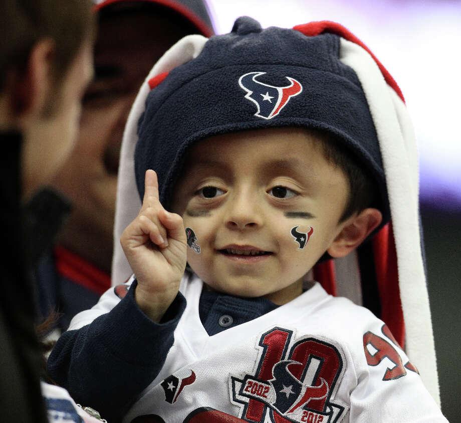 Matthew Medina, 5, of Houston, does his J.J. Watt (99) finger wag. (Karen Warren / Chronicle) Photo: Karen Warren, Houston Chronicle / © 2012 Houston Chronicle