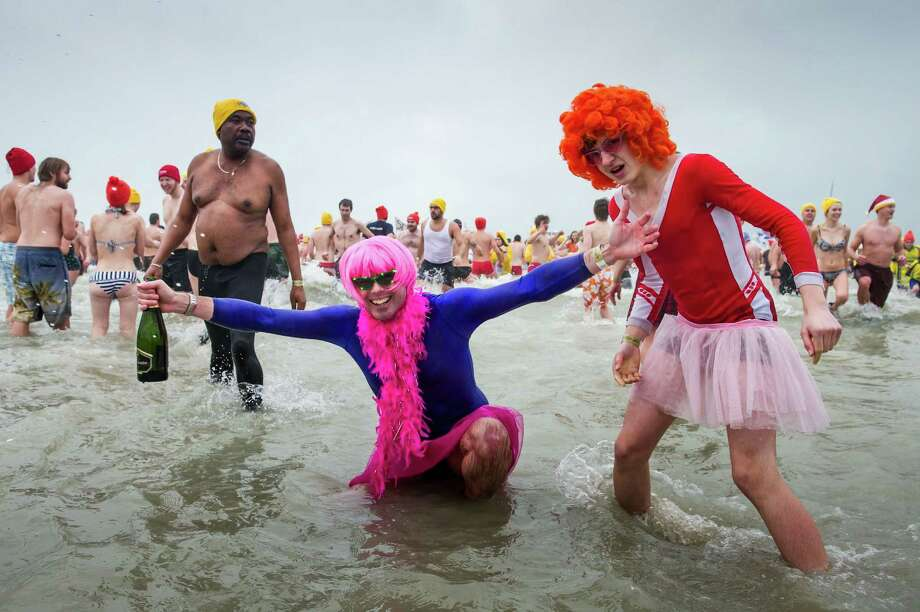 With temperatures around 8 degrees Celsius (46 degrees Fahrenheit),  people play in the surf, with some thousands celebrating the New Year by jumping into the North Sea during the traditional New Year's Dive in Ostend, Belgium, Saturday Jan. 5, 2013. Photo: Geert Vanden Wijngaert, Associated Press / AP
