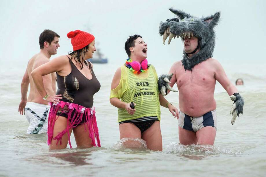 With temperatures around 8 degrees Celsius (46 degrees Fahrenheit),  people are dressed for the occasion as they play in the surf, with some thousands celebrating the New Year by jumping into the North Sea during the traditional New Year's Dive in Ostend, Belgium, Saturday Jan. 5, 2013. Photo: Geert Vanden Wijngaert, Associated Press / AP