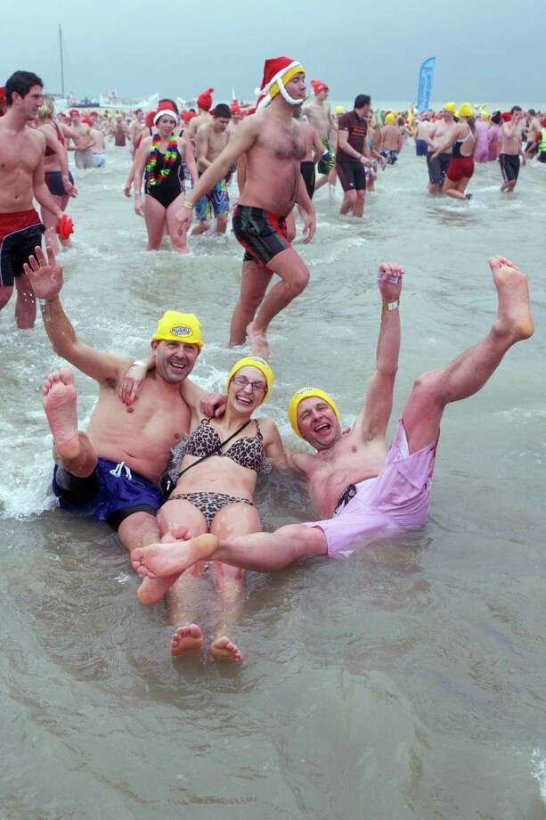 People take part in the traditional New Year's dive (Nieuwjaarsduik) into the North Sea in Ostend, on January 5, 2013. Photo: KURT DESPLENTER, AFP/Getty Images / Foto Kurt bvba