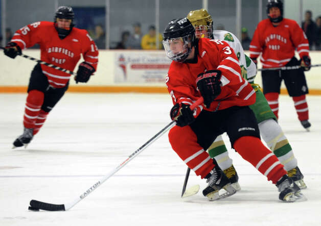 Fairfield Prep's #3 Matt Wikman controls the puck, during boys hockey action against Notre Dame of West Haven in West Haven, Conn. on Saturday January 5, 2013. Photo: Christian Abraham / Connecticut Post