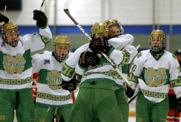 Notre Dame of West Haven celebrates a goal, during boys hockey action against Fairfield Prep in West Haven, Conn. on Saturday January 5, 2013. Photo: Christian Abraham / Connecticut Post