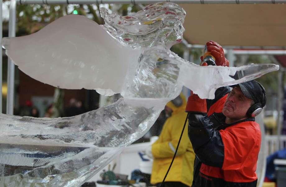 Steve Brice completes his ice sculpture during The Magnificent 7 Ice Carving Competition at Discovery Green on Saturday, Jan. 5, 2013, in Houston. Photo: Mayra Beltran, Houston Chronicle / © 2012 Houston Chronicle