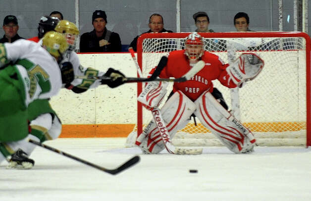 Fairfield Prep goalie Matt Beck gets ready to block a Notre Dame of West Haven advance, during boys hockey action in West Haven, Conn. on Saturday January 5, 2013. Photo: Christian Abraham / Connecticut Post