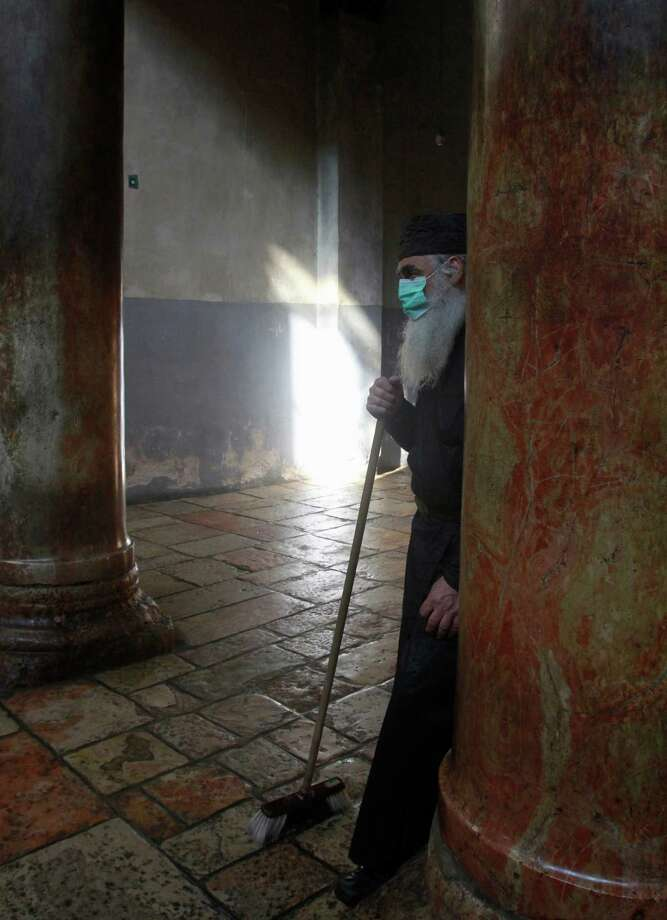 An Orthodox priest takes part in the cleaning of the Church of Nativity on January 2, 2013, in the West Bank town of Bethlehem. The sovereignty of the Church of the Nativity, traditionally believed to be the birthplace of Jesus Christ, is shared by the Christian denominations, who also share the annual cleaning responsibilities. Photo: MUSA AL-SHAER, AFP/Getty Images / AFP ImageForum