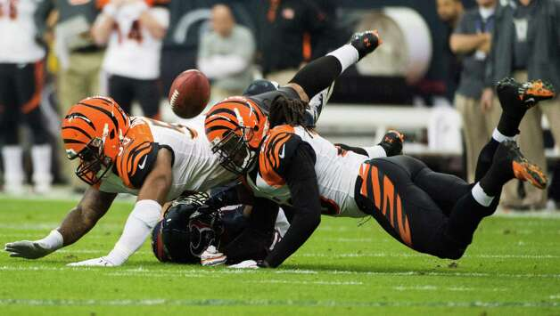 Cincinnati Bengals strong safety Chris Crocker (33) and free safety Reggie Nelson (20) knock a pass away from Houston Texans tight end Owen Daniels (81) during the first half of an NFL playoff football game at Reliant Stadium on Saturday, Jan. 5, 2013, in Houston. Photo: Smiley N. Pool, Houston Chronicle / © 2013  Houston Chronicle