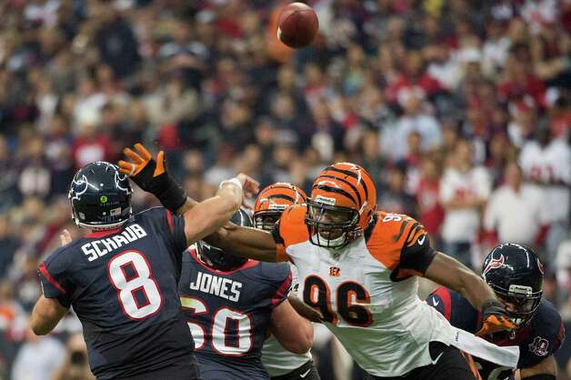 Houston Texans quarterback Matt Schaub (8) gets off a pass as Cincinnati Bengals defensive end Carlos Dunlap (96) applies pressure during the first half of an NFL playoff football game at Reliant Stadium on Saturday, Jan. 5, 2013, in Houston. Photo: Smiley N. Pool, Houston Chronicle / © 2013  Houston Chronicle