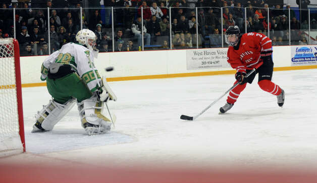Notre Dame of West Haven goalie Luciano Amatruda deflects a penalty shot by Fairfield Prep's #3 Matt Wikman, during boys hockey action in West Haven, Conn. on Saturday January 5, 2013. Photo: Christian Abraham / Connecticut Post
