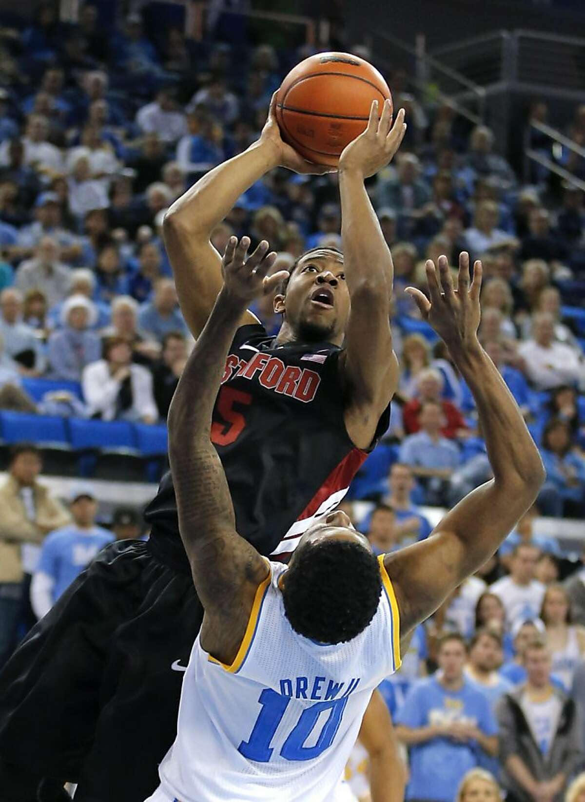 Stanford's Chasson Randle, top, shoots over UCLA's Larry Drew II during the first half of an NCAA college basketball game in Los Angeles, Saturday, Jan. 5, 2013. (AP Photo/Jae C. Hong)