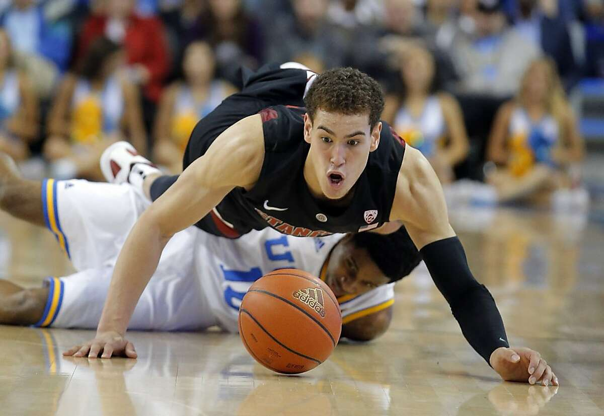 Stanford's Dwight Powell, top, goes after a loose ball against UCLA's Larry Drew II during the second half of an NCAA college basketball game in Los Angeles, Saturday, Jan. 5, 2013. UCLA won 68-60(AP Photo/Jae C. Hong)